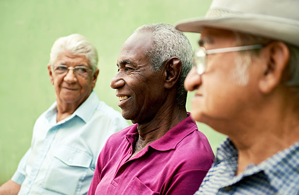 Three senior men sitting together.
