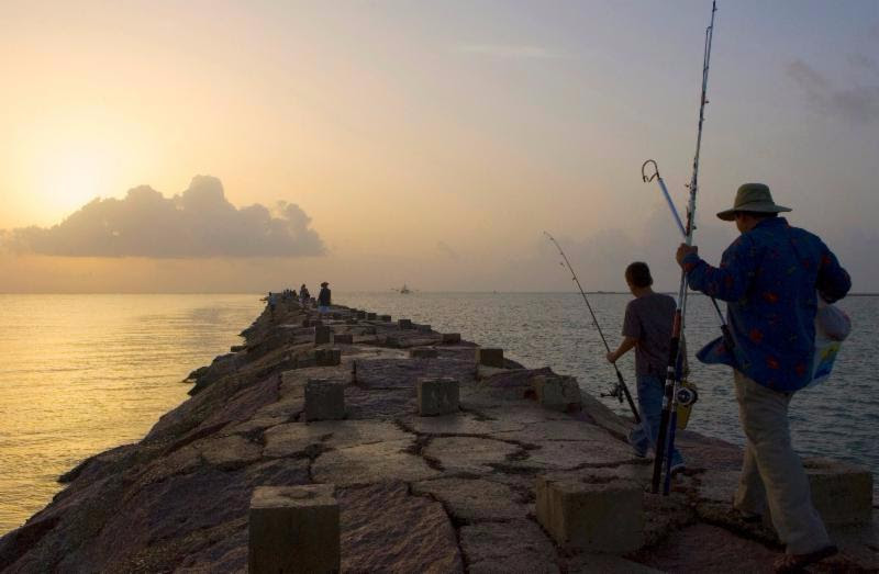 Fishing in the Gulf at sunrise
