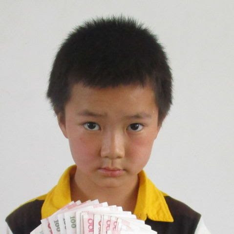 Qianjun is from Yangdi and in the 4th grade. His Father died and his mother remarried. He lives with grandparents.