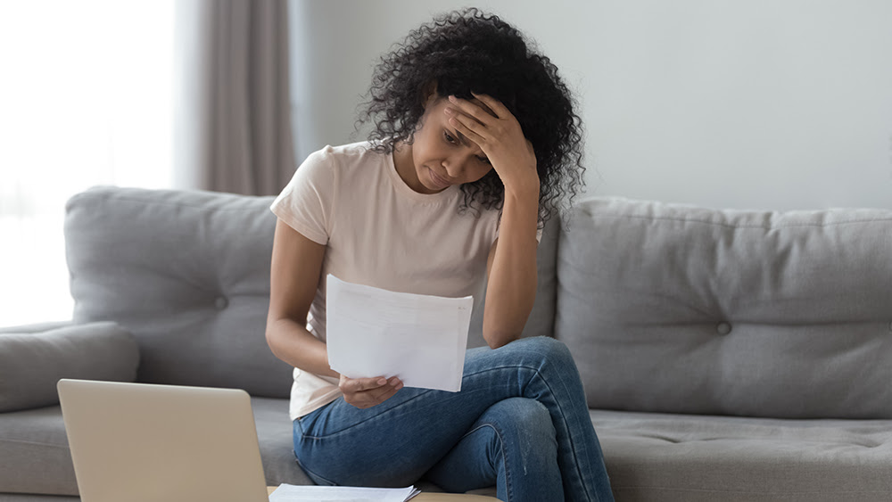 Woman looking stressed because of money worries