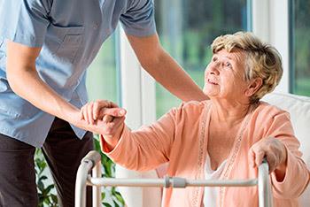 Photo: older woman getting help walking
