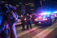 The scene following the sniper shooting in Dallas on Thursday. Police said they used the department's bomb robot early Friday to kill a suspect.