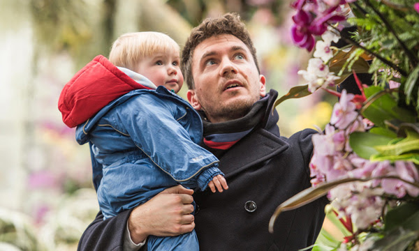 Image of a father and child at Orchids