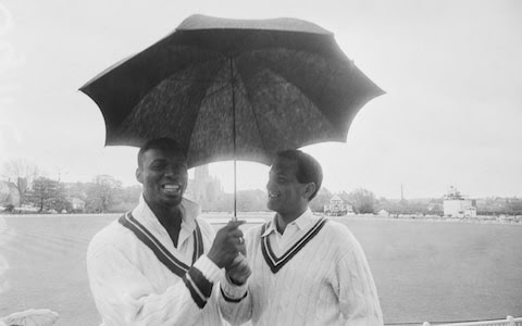 England cricketer Basil D'Oliveira, right, shown in 1966 with Barbadian cricketer Wes Hall