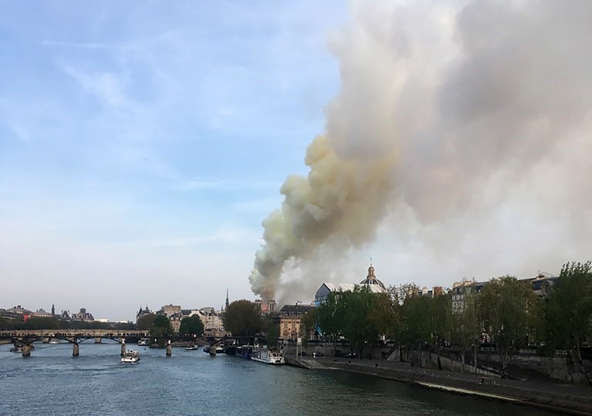 Slide 22 of 31: Flames and smoke are seen billowing from the roof at Notre-Dame Cathedral in Paris on April 15, 2019. - A fire broke out at the landmark Notre-Dame Cathedral in central Paris, potentially involving renovation works being carried out at the site, the fire service said.Images posted on social media showed flames and huge clouds of smoke billowing above the roof of the gothic cathedral, the most visited historic monument in Europe. (Photo by Pierre Galey / AFP)        (Photo credit should read PIERRE GALEY/AFP/Getty Images)