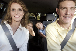 image of a happy family taking a drive