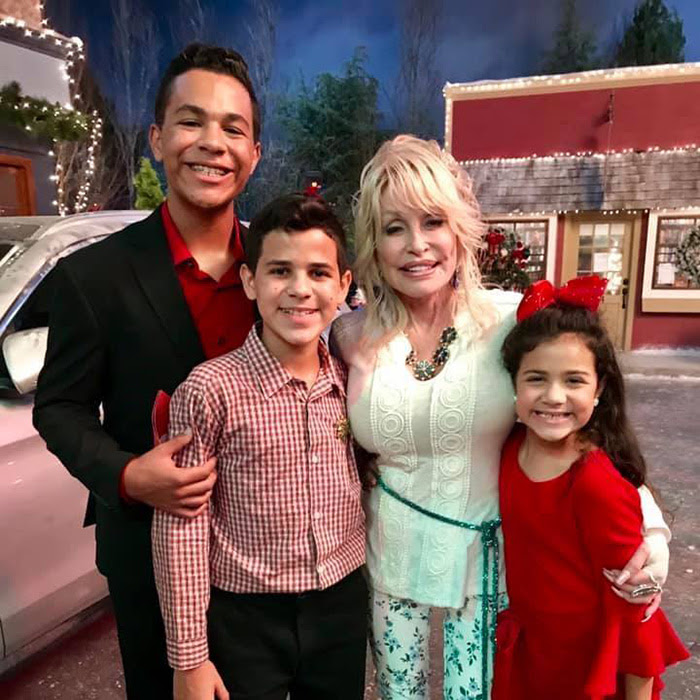 Sixteen-year-old Tristan, 13-year-old Tyson, and 9-year-old Talia with Dolly