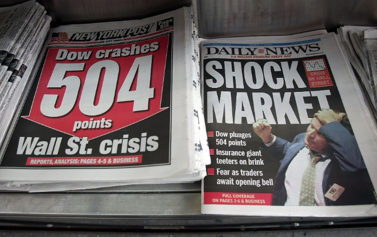 Newspapers are seen for sale at a newsstand Sept. 16, 2008 in New York City. U.S. stocks were mixed following the Sept. 15, 2008 Dow Jones Industrial Average plunge of 4.4 percent or 504 points – the worst single day loss since the 9/11 attacks. Mario Tama/Getty Images