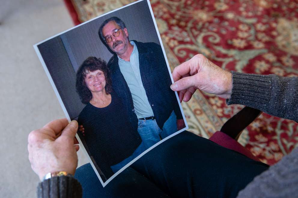 """Doris Levering holds a photograph of her and her husband predating his surgery. Levering says it's clear that the man who used to tend to stray cats and enjoy dinner out with his family is gone. """"People's lives are at stake. Mark's life will never be the same,"""" she says."""