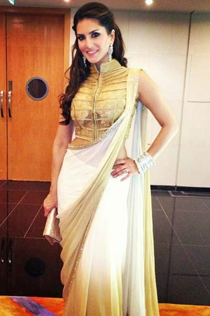 Sunny Leone poses in white and golden saree