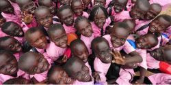 Photo of about two dozen children of South Sudan