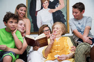 Kitty Axelson-Berry, center, with her client Sonia Ehrlich, a Holocaust survivor, and Ms. Ehrlich's great-grandchildren, Jacob, 9; Ayden, 14; and Zachary, 12. At top left is Ms. Ehrlich's granddaughter, Jordan Levine.