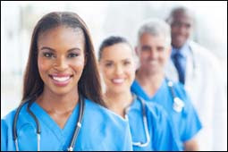 The figure above is a photograph showing a group of health care workers.