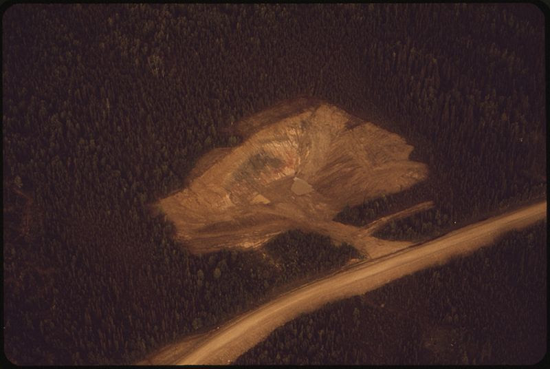 File:A STATE OF ALASKA HIGHWAY DEPARTMENT GRAVEL PIT LOCATED A MILE EAST OF THE PIPELINE ROUTE. CONTRACTORS BUILDING THE... - NARA - 550568.jpg