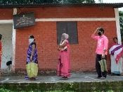 People queue to buy vegetables, Guwahati, India, April 29, 2020.
