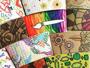 a collection of decorated coffee sleeves