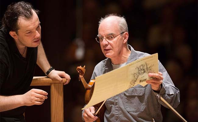 [Malcolm Lowe and Andris Nelsons look over score during rehearsal; Photo by Marco Borggreve]