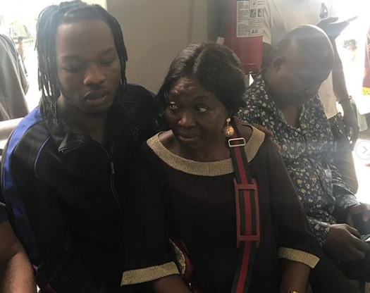 Naira Marley Poses in Court With His Mother [Photos]