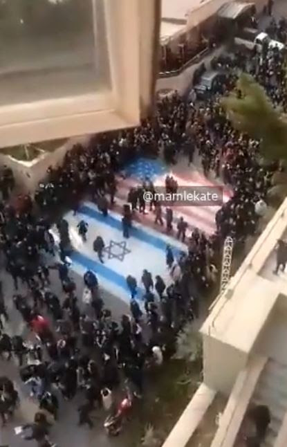 The crowd turned on the few who walked over the murals