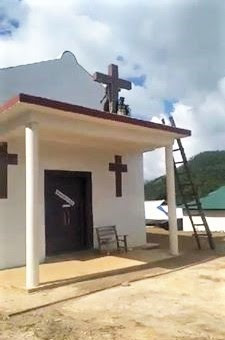 A United Wa State Army (UWSA) militant begins toppling cross on church building in rebel-held territory in Shan state, Burma (Myanmar), in photo circulated on Facebook. (Morning Star News via Facebook)