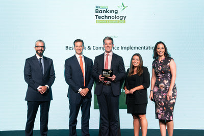"""(From left to right) Omar Al Gharabally, President & Chief Placement Officer, Damian Grice, Chief Operating Officer, Jeff Evans (center), Managing Director, Sarah Hillman, General Counsel, and Alison Fairweather, Head of Compliance, accepting the """"Best Risk & Compliance Implementation"""" award at the MEA Finance Banking Technology Awards."""
