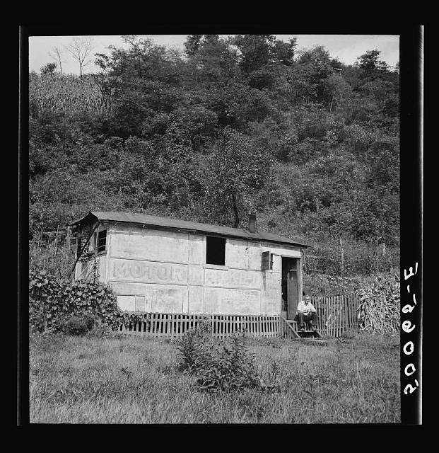 "Unemployed miner's home he built. ""It'll be purtier when I paint it.""  Scott's Run, West Virginia. Osage, West Virginia"