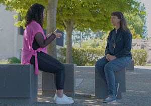 Mentor and mentee talking together while sitting outside