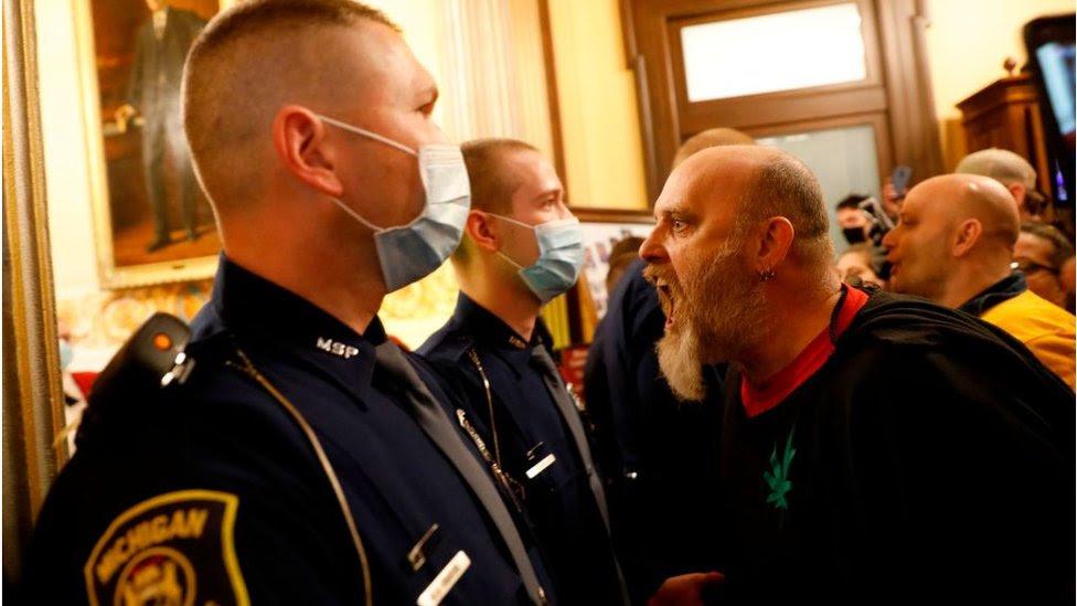 Coronavirus: Armed protesters enter Michigan statehouse