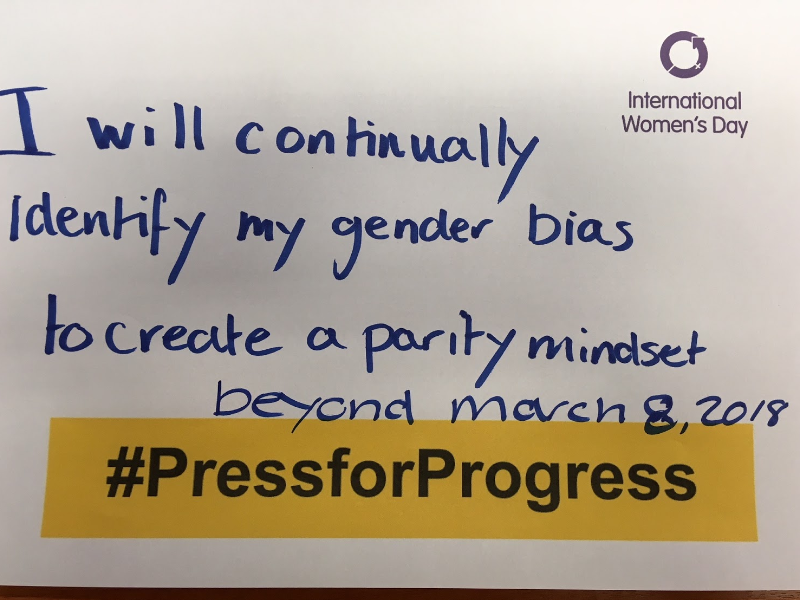 Photo of a handwritten statement reading 'I will continually identify with my gender bias to create a parity mindset beyond March 8, 2018' for International Women's Day
