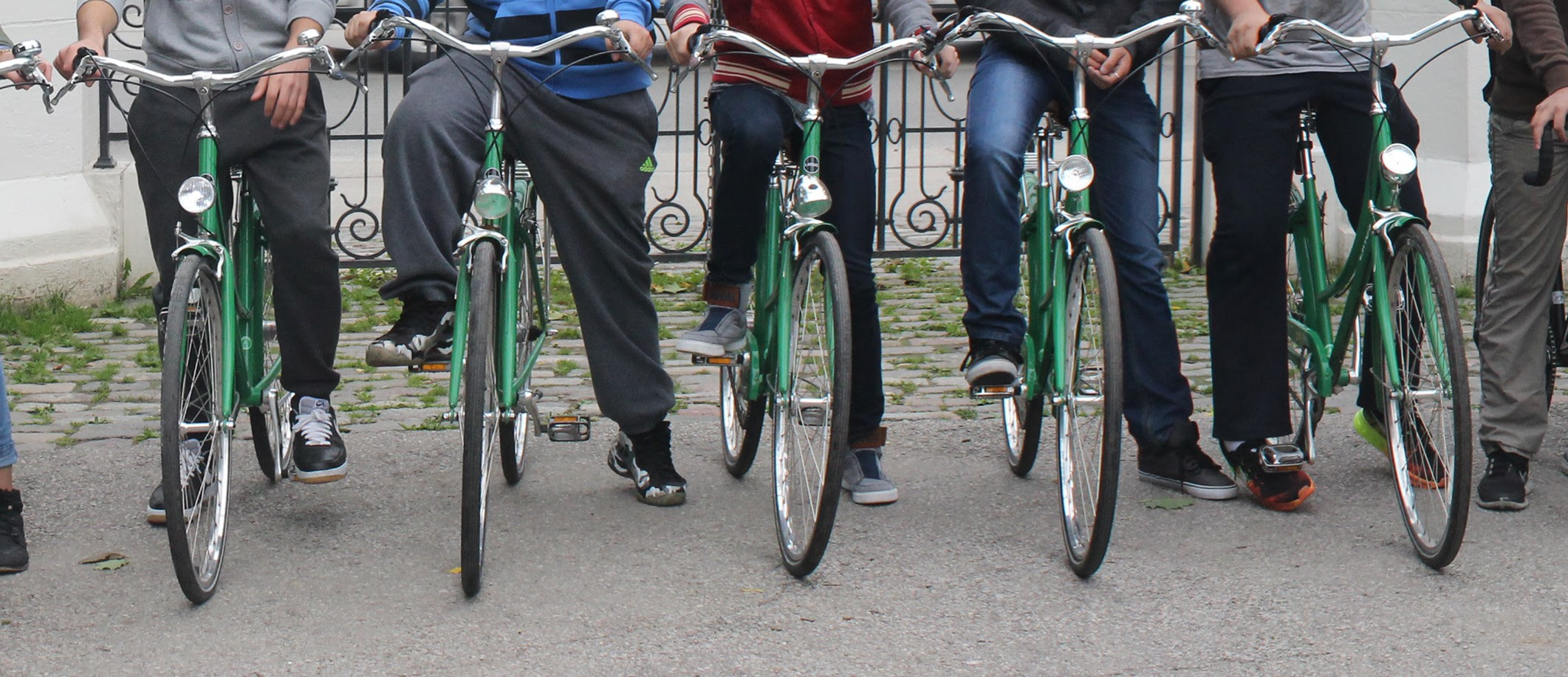 Youth on bikes with one foot on the ground