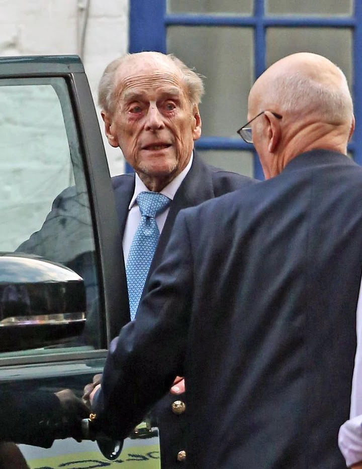 The Duke was shown to the front seat of a car before being driven away