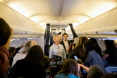 Hillary Clinton greeted members of the news media on Monday on her new charter plane on her way to Cleveland.