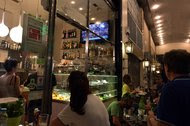 Greeks watching television coverage of a rally in July last year in a cafe in Athens. The government opened TV broadcasting to unregulated private entities in the 1980s.