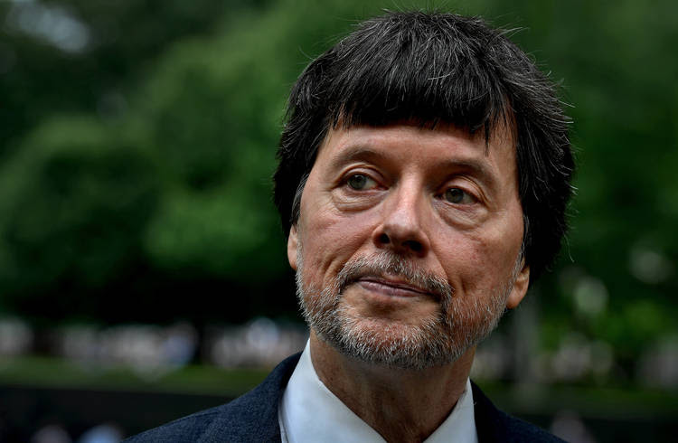 Documentary filmmaker Ken Burns visits the Vietnam Veterans Memorial Wall in May. (Michael S. Williamson/The Washington Post)
