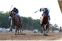 Authentic (inside) and Ny Traffic battle to the wire in the July 12 Haskell Invitational Stakes at Monmouth Park