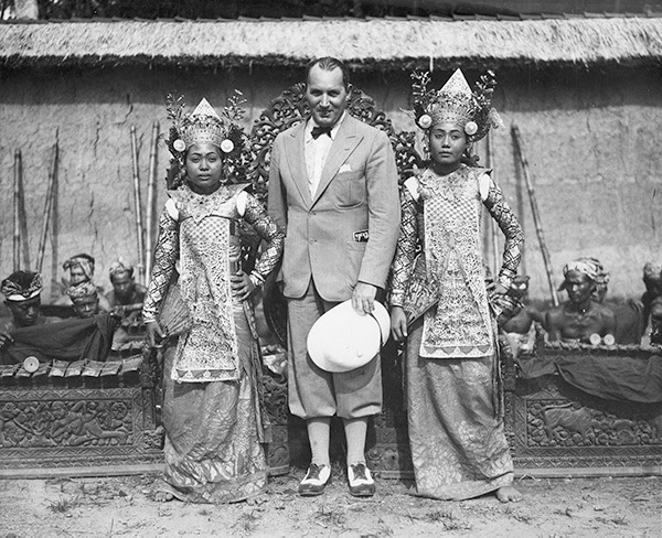 Robert Ripley standing with two Balinese dancers. He considered the people of Bali to be