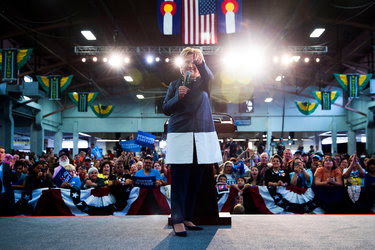 Hillary Clinton at a campaign rally at the Colorado State Fair grounds in Pueblo on Wednesday. The candidate is keeping a relatively low profile, content for her rival to remain in the glare of the spotlight.