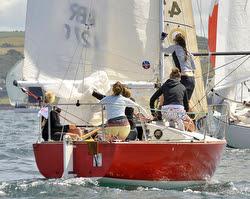J/24 Poole girls sailing team- setting spinnaker