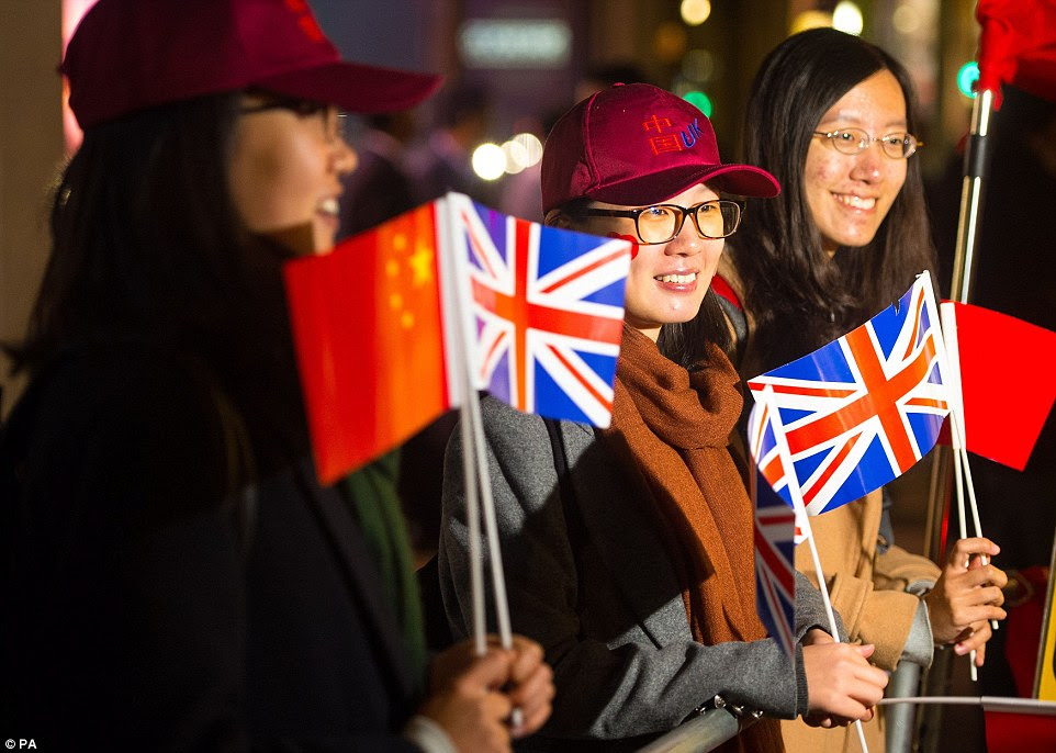 Supporters of Mr Xi gather outside the Mandarin Oriental Hotel, in Knightsbridge, London, where the president is spending the first night of his state visit