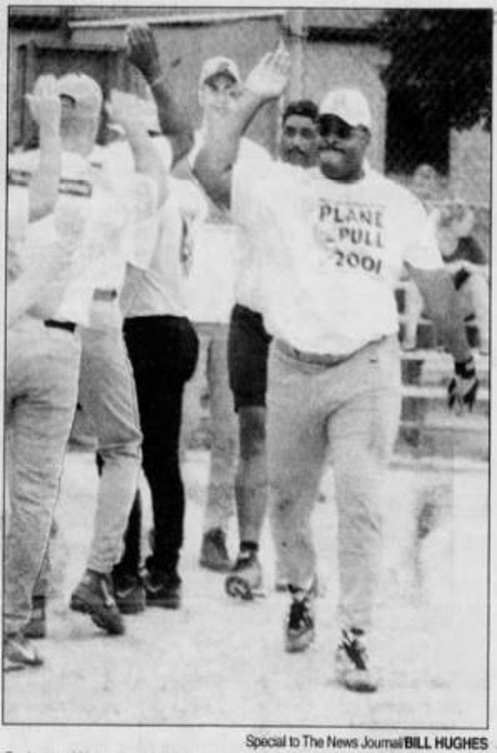 In this file photo from The News Journal archives, Quinton Watson gets high-fives after hitting a home run during a softball game against a team from the Delaware State Police. Watson was with the New Castle County Police Department for more than 30 years.