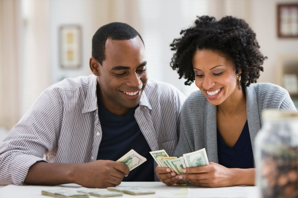 Couple counting their cash