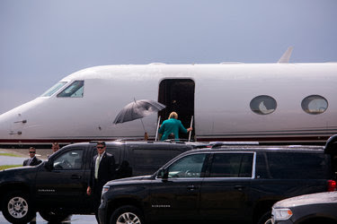 Hillary Clinton boarded a charter plane in Des Moines on Wednesday. More emails have emerged that critics say show lapses in judgment by the candidate.