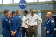 President Obama and Michelle Obama speaking to Mark Kelly, right, and other astronauts at the Kennedy Space Center in 2011.