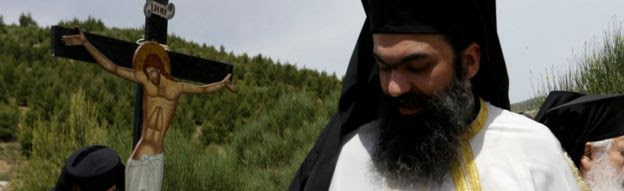 Greek Orthodox priests take part in a Good Friday re-enactment on 29 April