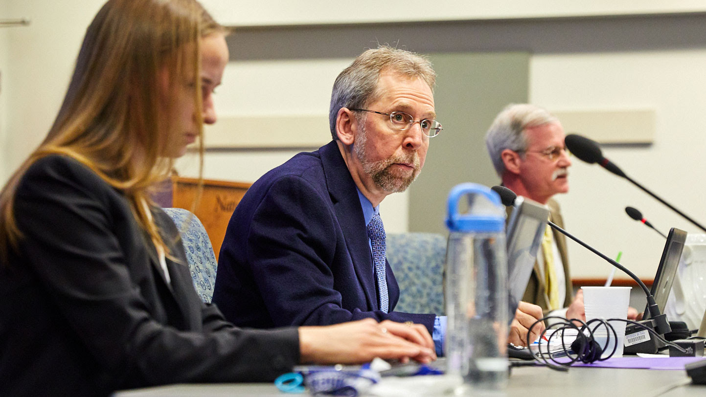 Members of the National Advisory Council for Human Genome Research discuss topics related to genetics and genomics