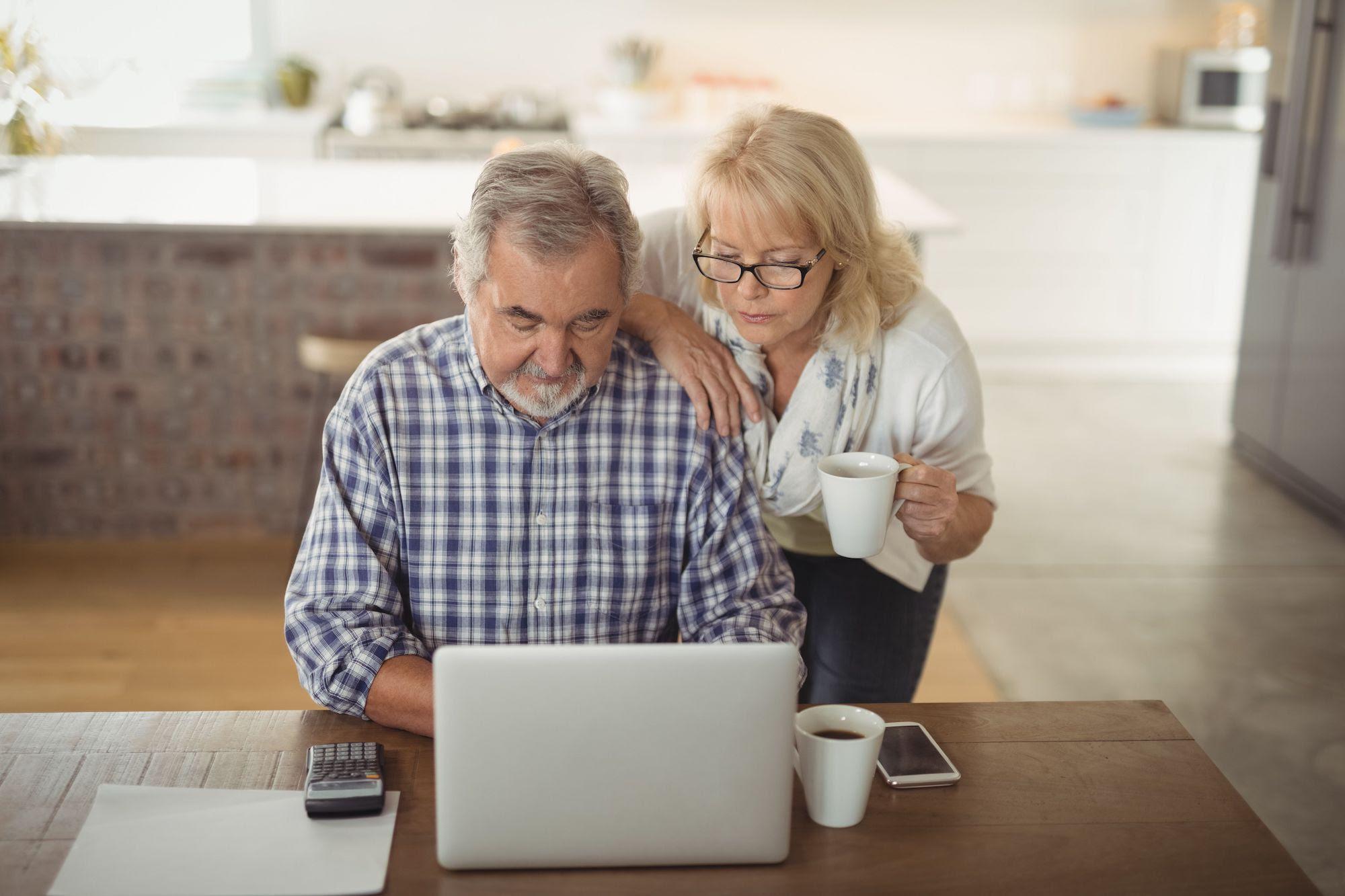 pikwizard-senior-couple-using-laptop (1).jpg