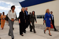 Cheryl Mills, left, with Hillary Clinton, then the secretary of state, attended the grand opening of a new industrial park in Haiti in October 2012.