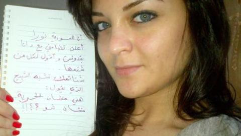 Syrian activist Noura shows her support to the Uprising of Women in the Arab World. Source: the Uprising´s facebook page