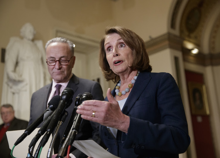 House Democratic Leader Nancy Pelosi and Senate Democratic Leader Chuck Schumer speak to reporters in March. (J. Scott Applewhite/AP)</p>