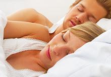 Photo of a sleeping couple.